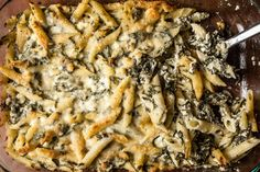 An easy recipe for baked penne pasta with spinach and feta cheese.