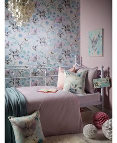 This enchanting fairytale themed wallpaper features unicorns and fairy castles on a pretty pink and blue background patterned with leaves and snowflakes. For added magic, the design has been infused with glitter to give that extra sparkle to your room.