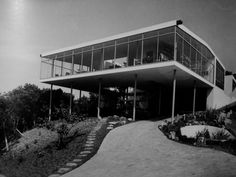 """Lina Bo Bardi, icon of modernist architecture in Brazil. Born in Italy, moved to São Paulo in 1946 because it had a profound effect on her creative thinking. While becoming a naturalized citizen in 1951, she completed her first project, also served as her home, """"Glass House"""", south of São Paulo. Now national architectural monument. Known for use of items associated with advanced manufacturing techniques. Structure composed of steel tubes, slabs, other structural elements of reinforced…"""