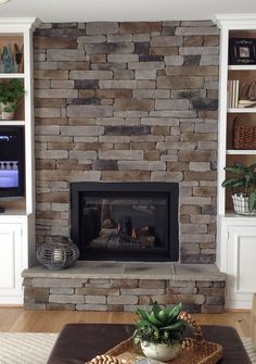 Stacked stone fireplaces are undeniably gorgeous and can turn what would…