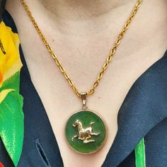 Vintage Goldtone and Green Glass Horse Pendant on Goldtone Chain. This adorable piece is perfect for any horse lover.