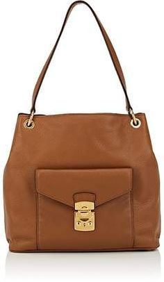 c9f18c1533 Miu Miu s brown grained leather shoulder bag is accented with polished  goldtone hardware.  handbags