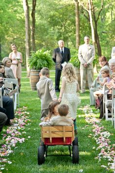 Flower Girls + Ring Bearers pulled in a red wagon I Golightly Images I #flowergirls #ringbearer