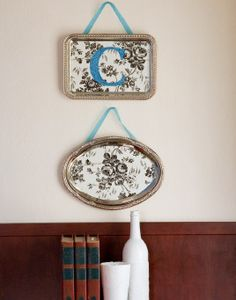 Platter Wall Hangings - We LOVE the look of groupings of antique silver platters hanging on walls all over the blogosphere. However, not everyone has a collection of antique silver serviceware. We figured out how to get the look for less than $2 a piece using our nickel-plated metal serving trays, ribbon, and self-adhesive shelf paper... and each one takes mere minutes to make.