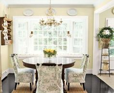 Dining Room Window light and airy. Dark table with contrasting chair covers