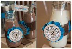 """Vintage """"Glass Milk Bottles - Old Starbucks Frappacino bottles (donated by a friend) had their labels removed and were sterilized to resemble vintage milk bottles.  Remnants of burlap fabric were used to cover tables & wrap milk bottles.  {Look how cute the bottles look with a few simple Anders Ruff printable embellishments!  2″ party logos were attached to handmade paper rosettes & party flags were attached to darling striped straws!}"""