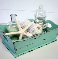 Shabby chic. perfect for a beach themed bathroom....just need to repurpose a tray or some other great thrift store find :)