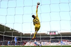Thibaut Courtois Photos - Thibaut Courtois of Chelsea makes a save during the Premier League match between Southampton and Chelsea at St Mary's Stadium on April 14, 2018 in Southampton, England. - Thibaut Courtois Photos - 1 of 769