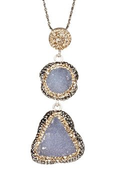 Druzy set in Crystal Clay and decorated with tiny Swarovski chatons.  What a great idea!