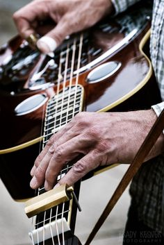 A  bluegrass musician's hands on a Dobro