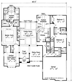 Carrollton House Plan - Coffered ceilings and built-in bookcases give the Carrollton's family room the attractive design elements that homeowners dream of.