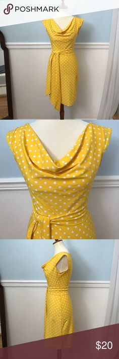 Yellow & White Polka Dot Retro Dress Yellow and white polka dot retro dress. In great condition. Only worn twice. Slight cowl neck line. Capped sleeves. Very stretchy spandex material. Tag is missing but this would fit small or XS or between 0 and 2. Dresses