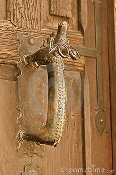 Ancient door handle, San Miguel de Allende, Mexico by Uli Danner, via Dreamstime