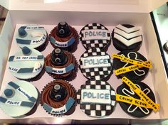 Police Themed cupcakes. Very happy with the chalk guys, csi tape and old fashioned black helmets!