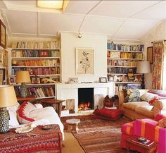 Love this room with the saggy shelves and the warming pinks. I think the white expanses keep it from seeming cluttery.