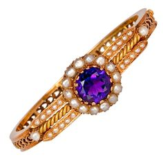 Antique Victorian Era Amethyst Jewelry The bracelet was made in Moscow between 1882 and It features a beautiful intense purple round cut Siberian amethyst in split pearl surrounding. The amethyst is approximately ct. Antique Bracelets, Antique Jewelry, Jewelry Bracelets, Vintage Jewelry, Jewellery, Amethyst Bracelet, Amethyst Jewelry, Diamonds And Gold, Gold Bangles
