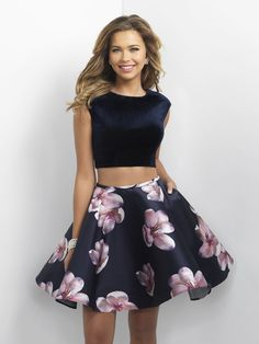 Dance the night away in this stylish floral print two-piece party dress with a velvet high-neck halter and low-cut back. It's at Rsvp Prom and Pageant, your source for the Hottest Homecoming, Prom and