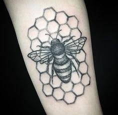 The work in this bee and honeycomb tattoo is so exquisite -- we can get lost in the hand poke style of Sarah Lu.