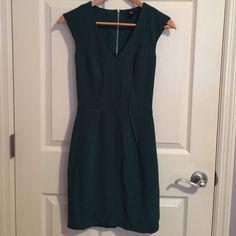 Dark green dress. Beautiful dark green dress. Never worn. I love it but it is too small for me. H&M Dresses