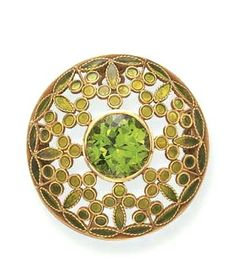 A PLIQUE-A-JOUR, PERIDOT AND ENAMEL BROOCH, BY LOUIS COMFORT TIFFANY, TIFFANY  CO. Centering upon a circular-cut peridot, within an openwork plique-a-jour green enamel foliate plaque, mounted in gold, (with concealed pendant hoop for suspension), circa 1910, in a Tiffany  Co. blue leather box Signed Tiffany  Co., nos. 213, 1206