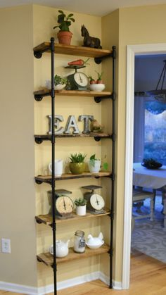 This wall is next to an angled wall so the open pipe shelves is really the perfect solution