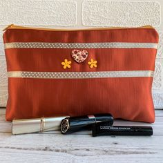 A large sized make up bag in a luxurious burnt orange satin fabric. The bag is trimmed with two rows of beige satin ribbon with a pattern of little white polka dots. Wooden Flowers, Orange Fabric, Wooden Hearts, Little Bag, Cool Items, Coral Pink, Satin Fabric, Burnt Orange, Cosmetic Bag