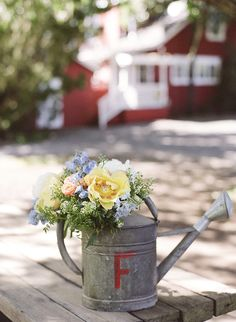vintage galvanized watering can table decor