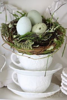 Such pretty cupboard displays like these stacked cups with a nest of eggs  P