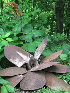 Hosta made from old shovels,rebar and old bolts!   Wish I knew how to weld!    Maybe I could use an adhesive of some sort to hold bolts to rebar?