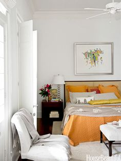 Orange accents. Design: Susan Noble Jones. housebeautiful.com. #orange #accent_colors #white #white_bedroom