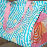 This beach bag is HUGE.  It can hold everything under the sun!  It is a quilted bag with cotton webbing handles.  If you can bind a quilt, you can make this bag.  This pattern uses fabric which you may choose to quilt yourself or buy pre-quilted.  A full size template is include for the sides of the bag.  This is a wonderful bag for the family and kids for short treks to grandma's or a weekend out in the sun.  Note:  This pattern is labeled skilled, since you will be sewing around curved ...