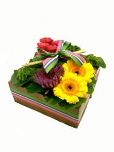 A playful, modern way to say thank you, happy birthday or anything else you would like to express, our Bento Box bouquet is a sunny explosion of vibrant colors and flowers arranged artfully in a natural wood box. The finishing touch is a pair of real chopsticks to help enjoy this feast for the eyes! $84.99