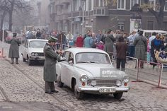 East Germans pass through a checkpoint into West Berlin after the opening of the Berlin Wall. 1989
