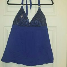Victorias secret bra top nwt Cobalt blue halter bra top with sequins at bust also comes with removable padding in bust. Low cut, baby doll style bottom for a flow fit. Ties behind neck.  Size large Victoria's Secret Tops Tank Tops