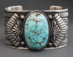 Sterling silver bracelet with gem grade #8 Nevada Turquoise cuff by Sunshine Reeves (Navajo). Heavy gauge sterling silver fans and sterling stars, hand cut turquoise cab with spider web matrix.