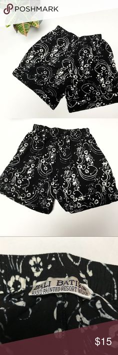 Bali Batiks Hand Painted Floral Shorts Hand Painted floral shorts from Bali Batiks. Size: L. Color: Black and white. Elastic waist shorts with hand painted flowers and side pockets. 2 inch split sides. Length: 19 inches. Bali Batiks Shorts
