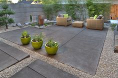 While contemporay, this backyard patio is low water & low maintenance