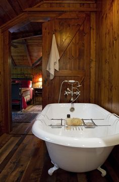 Rustic bathroom with a luxurious clawfoot tub. Barn Bathroom, Cabin Bathrooms, Rustic Bathrooms, Bathroom Ideas, Master Bathroom, Cozy Bathroom, Wooden Bathroom, Small Bathrooms, Bathroom Storage