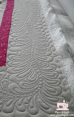 Feathers border quilting by Natalia Bonner at Piece N Quilt