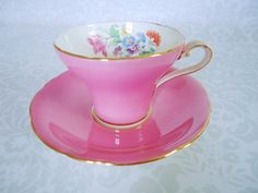 Pink https://www.etsy.com/listing/203689972/bright-pink-tea-cup-and-saucer-vintage