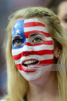 A US football fan has is face painted before the final of the women's football competition of the London 2012 Olympic Games on August 9, 2012 at…