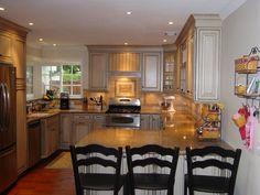 Cottage kitchen with a quaint corner window