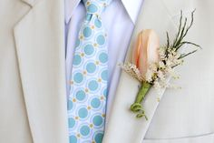 fun aqua & peach patterned tie, peach tulip bout, light khaki suit - photo by Moments by Sarah