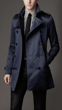 The perfect Burberry trench. Excellent with modern professional wear. A must have in a modern days business men's closet.