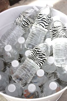 Duct tape dresses up party water bottles. They have so many cute patterned duct tape now this would be easy and super cute for a kids birthday party or baby shower, etc.... craft-ideas @Yolanda Pino
