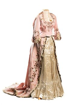 Rose silk faille dress, 1870s. Labeled Mme Gabrielle / Robes & Confections / 205 Rue St. Honoré, this elegant creation was designed by one of the premier couturiers of the 1860s and 1870s. The floral embroidery ornaments the bodice and the skirt, with its bustle and train. It was worn by Gertrude Ellen Dupuy who married Henry Shelton Sanford in 1864, both of wealthy American families. Gertrude was born in Philadelphia; they married in Paris and then lived in Brussels for a time.