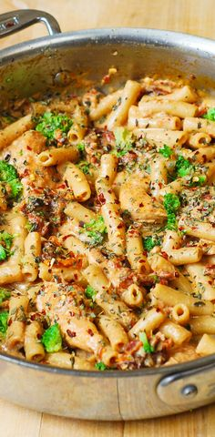 Chicken and Broccoli Pasta with Sun-Dried Tomato Cream Sauce: short, penne pasta smothered in a flavorful, creamy sauce spiced up with garlic, sun-dried tomatoes, basil and crushed red pepper flakes! JuliasAlbum.com #pasta #dinner