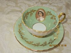 Antique Aynsley English bone china tea cup and saucer, vintage, 1957 Queen Eliabeth tea set, light green and white with gold fleur de lis