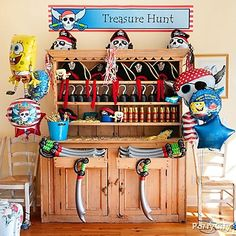 This living room hutch was transformed into a complete favor bar and dress-up center for a SpongeBob and the Pirates birthday party.