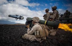 "A US Marine attached to Weapons Company, Battalion, Marine Regiment — ""The Lava Dogs"" — fires a Javelin at a simulated enemy tank during Lava Viper aboard Pohakuloa Training Area in Hawaii on May"